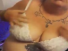 Granny strips and plays with her phat squirting pussy